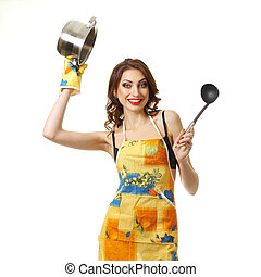 housewife tries a soup woman in an apron with a saucepan...