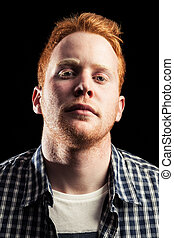 Serious boy - Serious redhead boy with black background