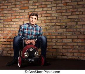 Young Man Playing with Toy Automobile - Good Looking Young...