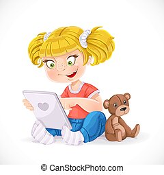 Beautiful little girl sitting on the floor with a tablet and a teddy bear