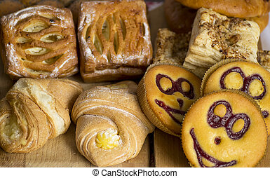 Baked goods - A variety of baked goods on a wooden table.