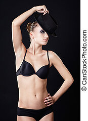 beautiful model in hat - portrait of beautiful dark haired...