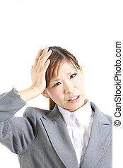 perplexed businesswoman - studio shot of young Japanese...