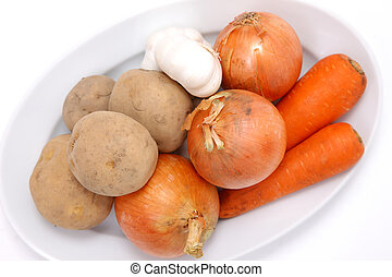 Root vegetables - group shot of root vegetables on white...