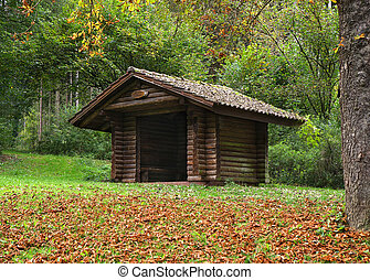 Wooden hut in the forest - Open brown wooden hut in the...