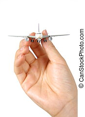 air plane - female hand with air plane on white background
