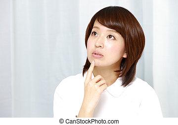nurse thinks about something - portrait of Japanese nurse...