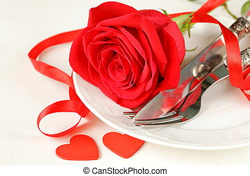 romantic table setting with roses for the holiday St...