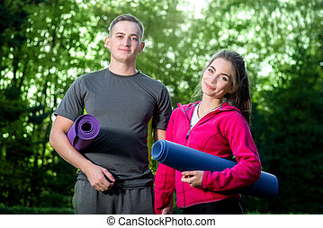 Sports couple in the park - Sports couple in sportwear...