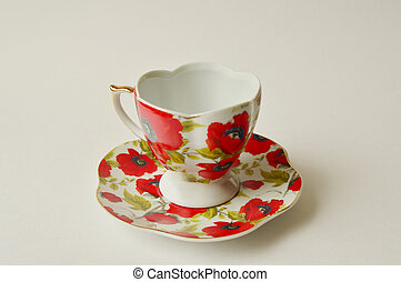 Cup and saucer with bright red poppies