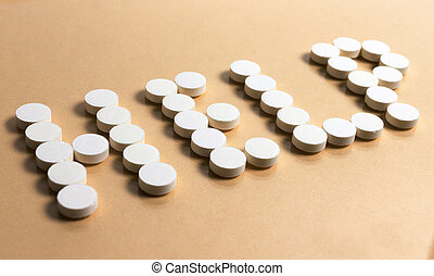 "pills forming the word ""HELP"""