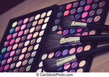 Makeup brush and eye shadow - Vintage looking colorful eye...