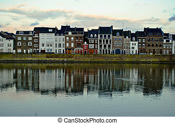 Maastricht. Maas, houses. - Photo of tupical houses in...