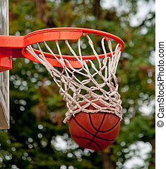 Ball in the basket - Photo of basketball ball in the net
