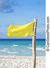 Beach yellow flag warning weather wind at Cuban turquoise sea