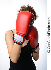 beautiful asian woman with the red boxing gloves guard her face