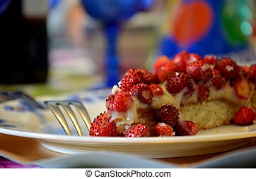 slice of cake strawberries and crea