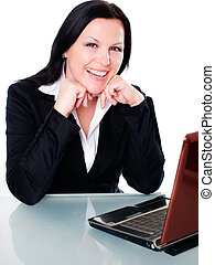 smiling brunette businesswoman in office with laptop