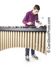 adolescente, Menino, tocando, Marimba, em, estúdio,
