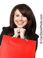 Shopping excitement - An crazy happy shopping girl holding...
