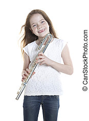 youn girl with brown hair and holding flute in studio with...
