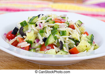 Mediterranean greek orzo pasta salad with black olive, red...