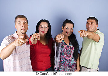 Group of people pointing