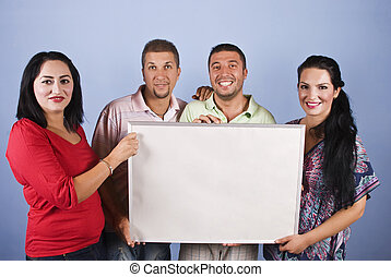 People group holding a billboard - Happy four people group...