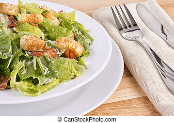Fresh caesar salad on wooden table View from above
