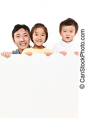 family with a white board on white background