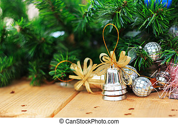 Christmas fir tree with decoration on a wooden board - Photo...