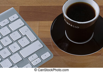 Keyboard and coffee cup - Grey wireless keyboard with white...