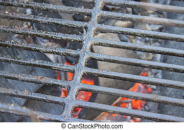 Glowing coals under the grid. Close up.