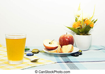 Apple juice with apple sliced on tablemat - Healthy snack...