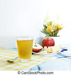 Cooled apple juice set on tablemat - Fresh apple juice on...