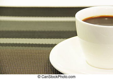 Half coffee on pattern napery - Abstract background coffee...