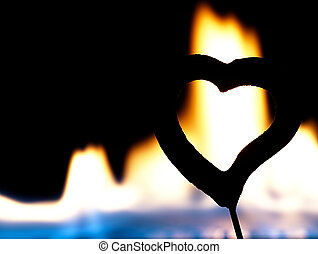 Flaming heart on a black background. - Fire burning heart....