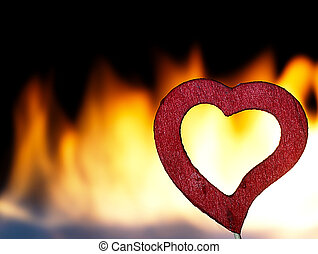 Flaming heart on a black background - Fire burning heart...