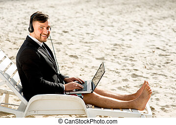 Businessman on the beach - Businessman dressed in suit and...