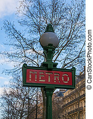 A Metro sign ion Paris - A sign post adverting a Metro...
