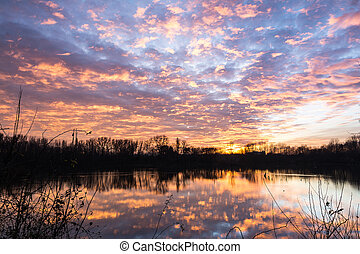 Sunset on lake - Sunset over a lake in the italy countryside...