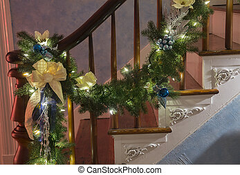 Christmas garland on bannister - Christmas garland with...