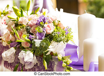 flowers and candles on celebratory table at restaurant