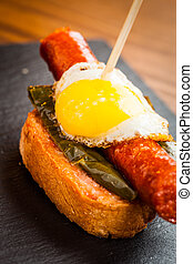 Spanish tapas - Typical spanish tapas with fried quail egg,...