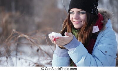 Girl blows snow - Beautiful girl blows snow from her hands