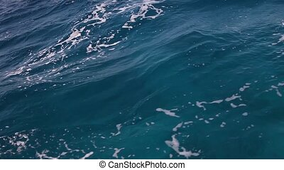 Red sea water nature background. Low angle view from boat....