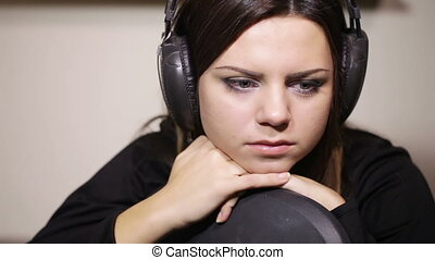 Bored Girl - Sitting on chair with headphones girl bored