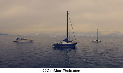 Yahts on the Lago MaggioreItaly H - Foggy weather on the...