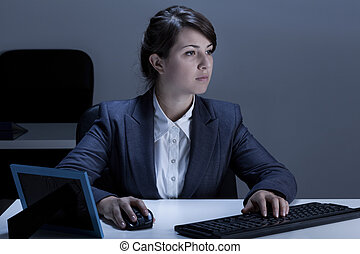 Female office worker during work - Image of female office...