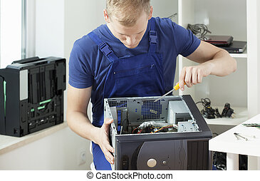 Trying to repair - Young handsome man trying to repair his...
